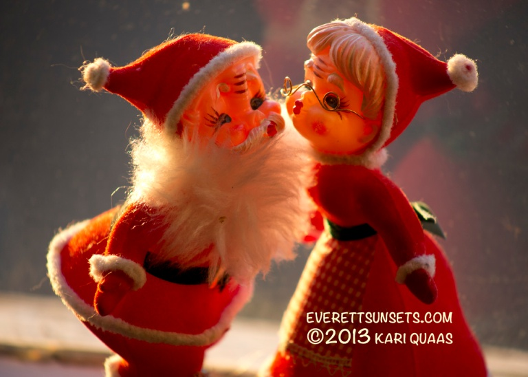 Kissing Saint Nick & Mrs. Claus by Kari Quaas